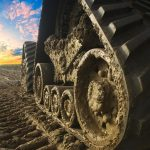 How tracks can ease the pressure on compacted soil and increase yields